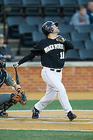 Nate Mondou (10) of the Wake Forest Demon Deacons follows through on his swing against the Missouri Tigers at Wake Forest Baseball Park on February 22, 2014 in Winston-Salem, North Carolina.  The Demon Deacons defeated the Tigers 1-0.  (Brian Westerholt/Four Seam Images)