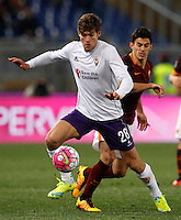 Calcio, Serie A: Roma vs Fiorentina. Roma, stadio Olimpico, 4 marzo 2016.<br /> Fiorentina's Marcos Alonso, left, is chased by Roma's Diego Perotti during the Italian Serie A football match between Roma and Fiorentina at Rome's Olympic stadium, 4 March 2016.<br /> UPDATE IMAGES PRESS/Riccardo De Luca