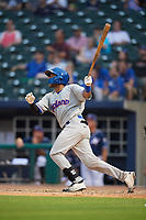 Midland RockHounds catcher Andy Paz (45) follows through on a swing during a game against the Northwest Arkansas Naturals on May 27, 2017 at Arvest Ballpark in Springdale, Arkansas.  NW Arkansas defeated Midland 3-2.  (Mike Janes/Four Seam Images)