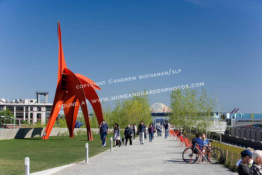 """The vivid red of Alexander Calder's, """"Eagle, 1971"""" contrasts with the vivid blue of a Northwest sky and the white snow capping Mt. Rainier some 60 miles distant as it lines up along the walking path known as the Moseley Path.   SAM's Olympic Sculpture Park, Seattle, WA."""