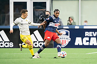 FOXBOROUGH, MA - MAY 16: Jen Bell #22 of New England Revolution passes the ball as Pedro Santos #7 Columbus SC pressures during a game between Columbus SC and New England Revolution at Gillette Stadium on May 16, 2021 in Foxborough, Massachusetts.