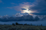 Wyoming, GTNP, Moon set in the dawn twilight over the Snow capped Teton Range.