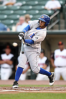 Durham Bulls third baseman Felipe Lopez #45 breaks his bat during a game against the Rochester Red Wings at Frontier Field on July 18, 2011 in Rochester, New York.  Durham defeated Rochester 4-1.  (Mike Janes/Four Seam Images)