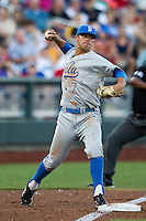 UCLA third baseman Kevin Kramer (7) makes a throw to first base as the third base umpire Gregory Street calls a foul ball against the North Carolina State Wolfpack during Game 8 of the 2013 Men's College World Series on June 18, 2013 at TD Ameritrade Park in Omaha, Nebraska. The Bruins defeated the Wolfpack 2-1, eliminating North Carolina State from the tournament. (Andrew Woolley/Four Seam Images)