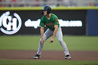 Evan Carter (11) of the Down East Wood Ducks takes his lead off of first base against the Kannapolis Cannon Ballers at Atrium Health Ballpark on May 5, 2021 in Kannapolis, North Carolina. (Brian Westerholt/Four Seam Images)