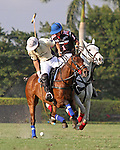 WELLINGTON, FL - FEBRUARY 05:  Diego Cavanaugh #4 of Valiente II controls the ball as Nico Escobar #1 of Orchard Hill looks on, during one of the early matches of the Ylvisaker Cup at the International Polo Club Palm Beach on February 05, 2017 in Wellington, Florida. (Photo by Liz Lamont/Eclipse Sportswire/Getty Images)