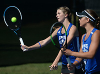 Rogers' JK Bohnert (left) returns a shot Tuesday, Oct. 12, 2021, alongside doubles partner Grace Lueders as they compete in the 6A state tennis finals at Memorial Park in Bentonville. Visit nwaonline.com/211013Daily/ for today's photo gallery.<br /> (NWA Democrat-Gazette/Andy Shupe)