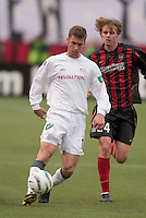 New England Revolution's Pat Noonan is chased by the 24 MetroStars' Eddie Gaven. The New England Revolution played the NY/NJ MetroStars to a 1 to 1 tie at Giant's Stadium, East Rutherford, NJ, on April 25, 2004.