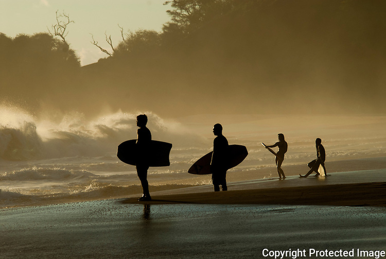 A few people looking at the power of the ocean. big beach can be an amazing wave to body board or surf.
