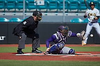Western Carolina Catamounts catcher Michael Goehrig (10) receives a pitch as home plate umpire Andrew Glenn looks on during the game against the Kennesaw State Owls at Springs Brooks Stadium on February 22, 2020 in Conway, South Carolina. The Owls defeated the Catamounts 12-0.  (Brian Westerholt/Four Seam Images)