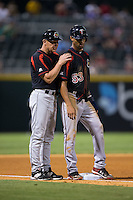 Rochester Red Wings manager Mike Quade (8) gives instructions to Byron Buxton (53) during the game against the Charlotte Knights at BB&T BallPark on August 8, 2015 in Charlotte, North Carolina.  The Red Wings defeated the Knights 3-0.  (Brian Westerholt/Four Seam Images)
