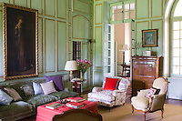 The walls of this drawing room are panelled in the French manner yet the furnishings are decidedly English in style
