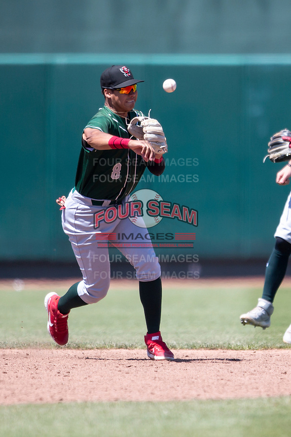 Great Lakes Loons shortstop Leonel Valera (8) makes a throw to first base on May 30, 2021 against the Lansing Lugnuts at Jackson Field in Lansing, Michigan. (Andrew Woolley/Four Seam Images)