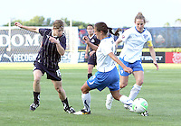 Rebecca Moros #19 of the Washington Freedom slips the ball past Stephanie Cox #14 of the Boston Breakers during a WPS match on May 8 2010, at the Maryland Soccerplex, in Boyds, Maryland. The game ended in a 0-0 tie.