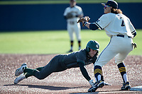 Michigan State outfielder Joe Stewart (5) dives back to first base during a pick-off attempt against the Michigan Wolverines on March 21, 2021 in NCAA baseball action at Ray Fisher Stadium in Ann Arbor, Michigan. Michigan scored 8 runs in the bottom of the ninth inning to defeat the Spartans 8-7. (Andrew Woolley/Four Seam Images)