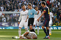 Spanish referee Miguel Angel Perez lasa have words with Real Madrid's Sergio Ramos (l) and  and FC Barcelona's Sergio Busquets  in presence of Pepe injured during La Liga match.March 02,2013. (ALTERPHOTOS/Acero) /NortePhoto