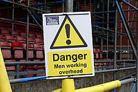 Danger, Men Working Overhead signage during Leyton Orient vs Oldham Athletic, Sky Bet EFL League 2 Football at The Breyer Group Stadium on 27th March 2021