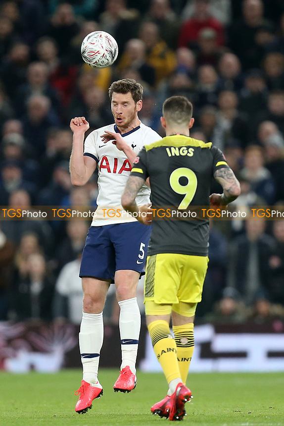 Jan Vertonghen of Tottenham Hotspur and Danny Ings of Southampton during Tottenham Hotspur vs Southampton, Emirates FA Cup Football at Tottenham Hotspur Stadium on 5th February 2020