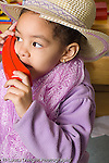 Preschool 3-4 year olds girl in dressup clothes pretend play talking on telephone vertical