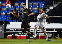 LAKE BUENA VISTA, FL - JULY 18: Mohamed El-Munir #13 of LAFC takes the ball off his chest while pressured by Rolf Feltscher #25 of LA Galaxy during a game between Los Angeles Galaxy and Los Angeles FC at ESPN Wide World of Sports on July 18, 2020 in Lake Buena Vista, Florida.