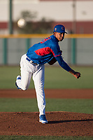 AZL Cubs 2 starting pitcher Yovanny Cruz (58) follows through on his delivery during an Arizona League game against the AZL Reds at Sloan Park on June 18, 2018 in Mesa, Arizona. AZL Cubs 2 defeated the AZL Reds 4-3. (Zachary Lucy/Four Seam Images)