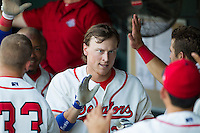 Wearing an Austin Senators throwback uniform, Round Rock Express outfielder Jim Adduci (24) is greeted in the dugout after hitting a home run during the Pacific Coast League baseball game against the Oklahoma City RedHawks on July 9, 2013 at the Dell Diamond in Round Rock, Texas. Round Rock defeated Oklahoma City 11-8. (Andrew Woolley/Four Seam Images)