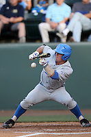 Tyler Heineman # 8 of the UCLA Bruins bunts against the TCU Horned Frogs at the Los Angeles super regionals at Jackie Robinson Stadium on June 9, 2012 in Los Angeles,California. UCLA defeated TCU 4-1.(Larry Goren/Four Seam Images)