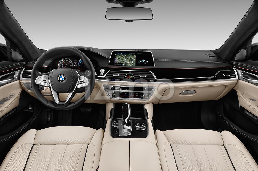 Stock photo of straight dashboard view of 2018 BMW 7-Series-Plug-In-Hybrid 740Le-iPerformance 4 Door Sedan Dashboard
