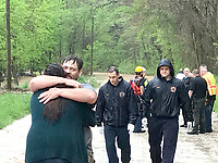 John Adams III hugged his girlfriend, Taylor, after he was rescued from flood waters Wednesday, April 28, 2021. (Photograph by Annette Beard)
