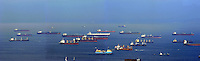 Container vessels moored off Singapore.
