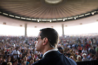 A Secret Service agent watches the crowd  as President Barrack Obama speaks in Holmdel, N.J...Photo by Brooks Kraft/Corbis..