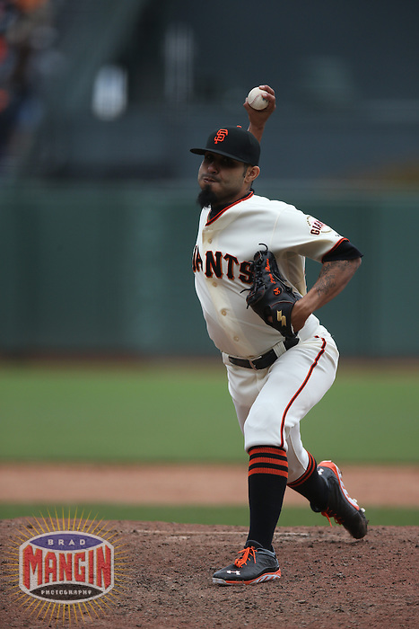 SAN FRANCISCO, CA - MAY 8:  Sergio Romo #54 of the San Francisco Giants pitches against the Philadelphia Phillies during the game at AT&T Park on Wednesday, May 8, 2013 in San Francisco, California. Photo by Brad Mangin
