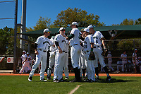 Dartmouth Big Green team huddle before taking the field during a game against the Villanova Wildcats on March 3, 2018 at North Charlotte Regional Park in Port Charlotte, Florida.  Dartmouth defeated Villanova 12-7.  (Mike Janes/Four Seam Images)