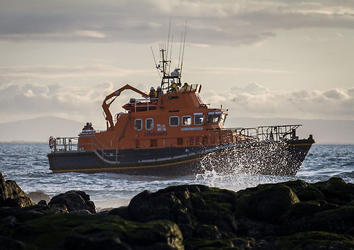 Portrush Lifeboat Launches to Paddle Boarders In Difficulty Off Ramore Head