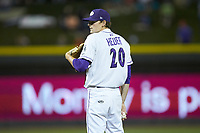 Winston-Salem Dash relief pitcher Codi Heuer (20) looks to his catcher for the sign against the Down East Wood Ducks at BB&T Ballpark on May 10, 2019 in Winston-Salem, North Carolina. The Wood Ducks defeated the Dash 9-2. (Brian Westerholt/Four Seam Images)