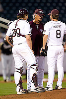 Assistant Coach Paul Evans (28) of the Missouri State Bears walks up to the mound during a game against the Purdue Boilermakers at Hammons Field on March 13, 2012 in Springfield, Missouri. (David Welker / Four Seam Images).