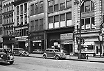 Pittsburgh PA: View of the stores on the 400 block of Wood Street.  Nearby stores include; Radio Mart, Kings Clothing, Klein's Shoes, John M Roberts and Sons, and Dimlings Candy