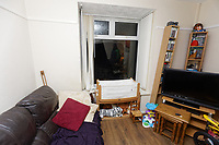 """Pictured: The smashed window in the front room at the house of Adam Romain in Waun-Wen Road in the Mayhill area of Swansea, Wales, UK. Thursday 20 May 2021<br /> Re: Gangs of """"yobs"""" have been setting fire to cars and rolling them down a hill in Swansea, Wales, UK.<br /> South Wales Police said they attended """"large scale disorder"""" in the Mayhill area of the city on Thursday evening."""