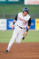 Danny Hayes (32) of the Kannapolis Intimidators hustles towards third base against the Hickory Crawdads at CMC-Northeast Stadium on May 5, 2014 in Kannapolis, North Carolina.  The Intimidators defeated the Crawdads 5-2.  (Brian Westerholt/Four Seam Images)