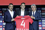 Atletico de Madrid's new player Santiago Arias (c) with the General Manager Andrea Berta (l) and the President Enrique Cerezo during his official presentation. August 13, 2018. (ALTERPHOTOS/Acero)