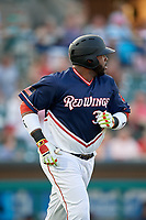 Rochester Red Wings designated hitter Kennys Vargas (30) runs to first base during a game against the Pawtucket Red Sox on July 4, 2018 at Frontier Field in Rochester, New York.  Pawtucket defeated Rochester 6-5.  (Mike Janes/Four Seam Images)