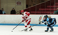 BOSTON, MA - JANUARY 04: Mackenna Parker #11 of Boston University controls the puck as Amalie Andersen #11 of University of Maine closes during a game between University of Maine and Boston University at Walter Brown Arena on January 04, 2020 in Boston, Massachusetts.