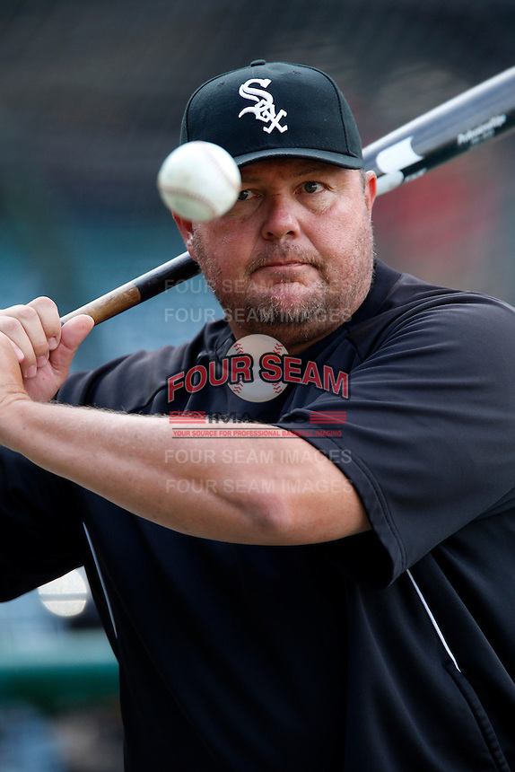 Chicago White Sox coach Mark Parent #8 hits fungos before a game against the Los Angeles Angels at Angel Stadium on September 22, 2012 in Anaheim, California. Los Angeles defeated Chicago 4-2. (Larry Goren/Four Seam Images)