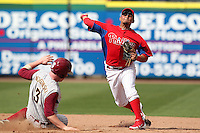 Philadelphia Phillies shortstop Freddy Galvis #13 attempts to turn a double play as John Nogowski #3 slides in during a scrimmage against the Florida State Seminoles at Brighthouse Field on February 29, 2012 in Clearwater, Florida.  Philadelphia defeated Florida State 6-1.  (Mike Janes/Four Seam Images)