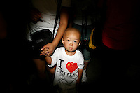 CHINA. Beijing. A young child wearing an 'I love China' t-shirt on Tiananmen Square during the Beijing 2008 Summer Olympics. 2008
