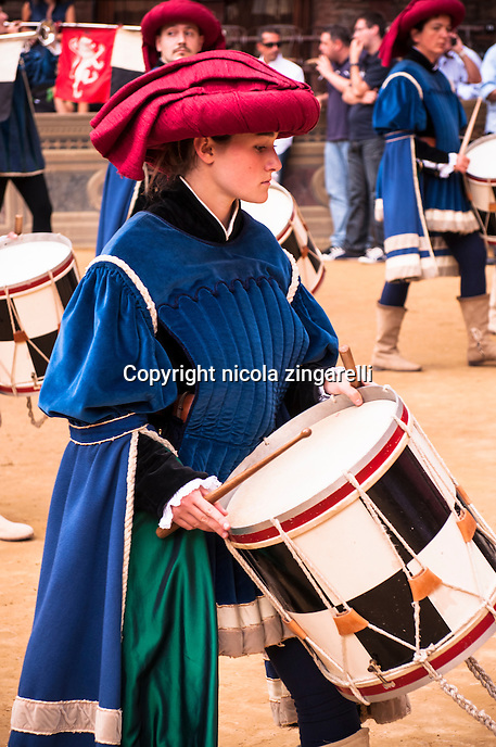 A young lady representing a drummer of the Palace during the Palio di Siena parade