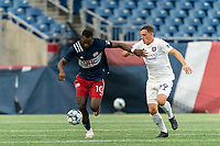 FOXBOROUGH, MA - AUGUST 7: Mayele Malango #10 of New England Revolution II brings the ball forward as Jose Quintero #59 of Orlando City B closes during a game between Orlando City B and New England Revolution II at Gillette Stadium on August 7, 2020 in Foxborough, Massachusetts.