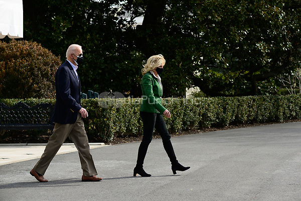 United States President Joe Biden and first lady Jill Biden walk on the South Lawn of the White House before boarding Marine One in Washington, D.C., U.S., on Friday, Feb. 26, 2021. Biden is visiting Texas today to discuss recovery efforts after winter weather caused widespread damage and left millions without power.<br /> Credit: Erin Scott / Pool via CNP /MediaPunch