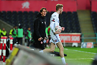 Thomas Frank Manager of Brentford is shown a yellow card after clashing with Oli McBurnie of Swansea City during the FA Cup Fifth Round match between Swansea City and Brentford at the Liberty Stadium in Swansea, Wales, UK. Sunday 17 February 2019