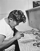 """0301-466A. """"Kachina Lodge July 1954""""  Herbert Quimayousie (also spelled """"Herbert Komayouse"""") (December 8, 1922 - September 27, 1994. born and died in Hotevilla, Apache, Arizona)."""